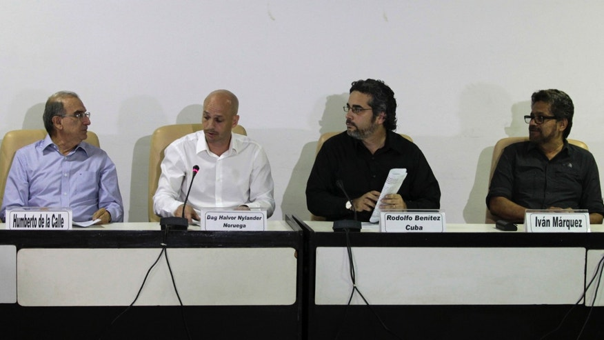 Humberto de la Calle, head of Colombia's government negotiation team, left, and Ivan Marquez, chief negotiator for the Revolutionary Armed Forces of Colombia, or FARC, right, talk during a press conference accompanied by Cuban guarantor Rodolfo Benitez, second from right, and Norwegian guarantor Dag Nylander, second from left, at the close of another round of peace talks in Havana, Cuba, Saturday, March 7, 2015. Colombiaâs government and the FARC have agreed to begin a pilot program for removing land mines as part of efforts to lower the intensity of a conflict that has lasted a half century. The announcement came Saturday at the end of the latest round of peace talks being held in Cubaâs capital since November 2012.  (AP Photo/Ismael Francisco, Cubadebate)