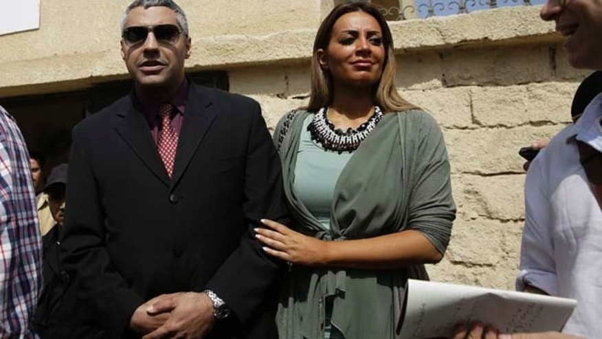 March 8, 2015: Canadian acting bureau chief of Al-Jazeera English, Mohamed Fahmy, left, leaves a court with his fiance Marwa Omara after a hearing in his retrial near Tora prison in Cairo, Egypt. (AP)