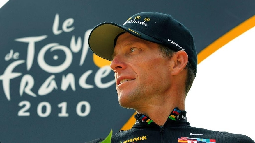 FILE - This file photo taken July 25, 2010, shows Lance Armstrong looking back on the podium after the 20th and last stage of the Tour de France cycling race in Paris, France. Cycling leaders let doping flourish and broke their own rules so Lance Armstrong could cheat his way to become a superstar the sport badly needed, according to a scathing report into its drug culture published Monday, March 9, 2015. The International Cycling Union was severely criticized for failing to act during the doping era dominated by Armstrong, but the 227-page report found no evidence that he paid to cover up alleged positive tests. (AP Photo/Bas Czerwinski, File)