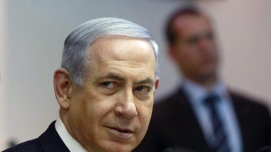 "Israeli Prime Minister Benjamin Netanyahu chairs the weekly cabinet meeting at his Jerusalem office, Sunday, March 8, 2015. Tens of thousands of Israelis gathered Saturday night at a Tel Aviv square under the banner ""Israel wants change"" and called for Netanyahu to be replaced in March 17 national elections. (AP Photo/Gali Tibbon, Pool)"