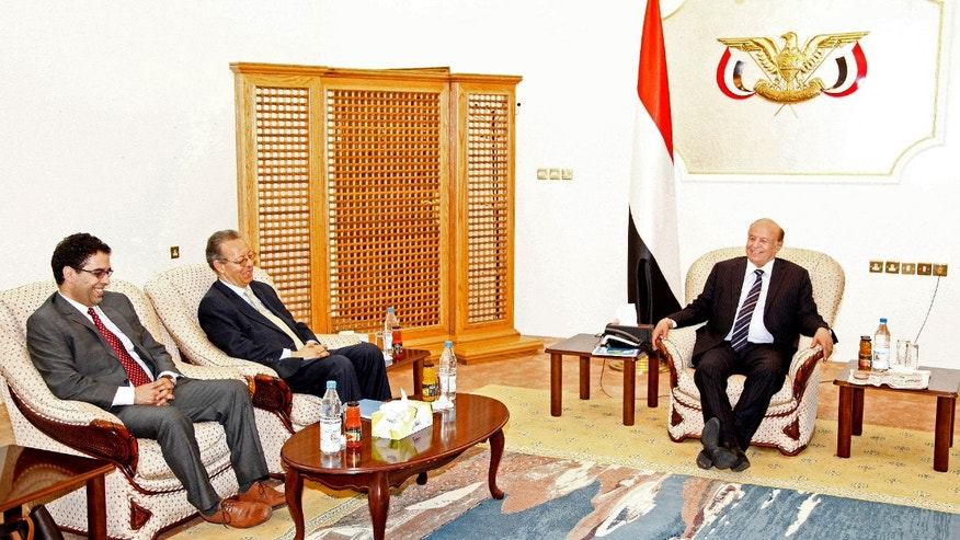 Feb. 26, 2015: Yemen's embattled President Abed Rabbo Mansour Hadi, right, meets U.N. envoy to Yemen, Jamal Benomar, left, at the Republican Palace in the southern port city of Aden, Yemen.