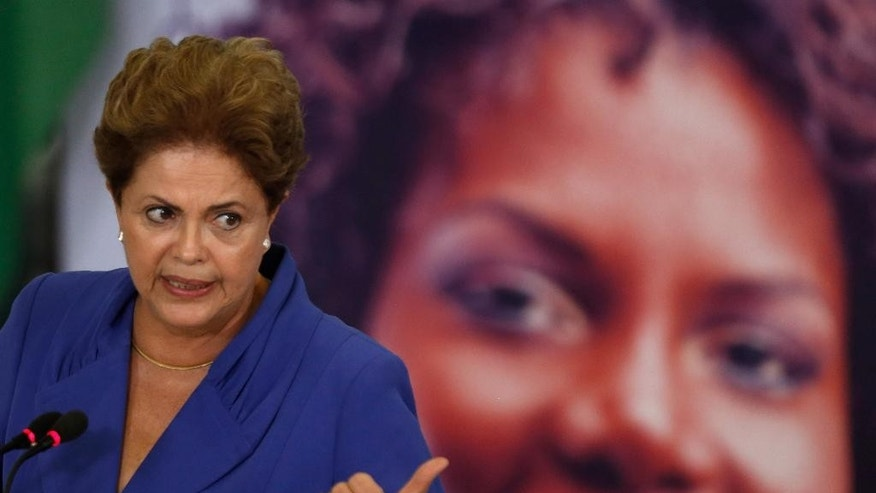 Brazil's President Dilma Rousseff speaks during a signing ceremony for a harsher law against femicide, at the Planalto Presidential Palace in Brasilia, Brazil, Monday, March 9, 2015. Rousseff said the new law is part of a zero tolerance policy toward the killing of women in cases involving domestic violence, contempt or discrimination against women. (AP Photo/Eraldo Peres)