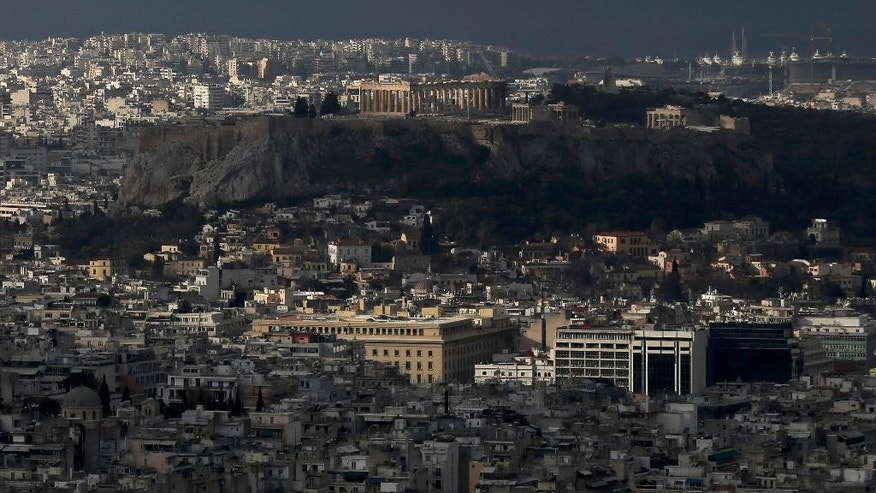 The sun lights the ancient Acropolis hill with the 5th century BC Parthenon temple, in Athens on Monday, March 9, 2015. Eurozone finance ministers will discuss about Greece at a Eurogroup meeting on Monday, as Athens had submitted seven reform proposals. (AP Photo/Petros Giannakouris)