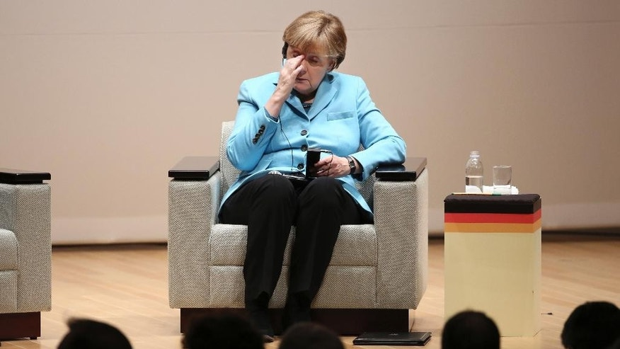 Germany's Chancellor Angela Merkel reacts during a lecture meeting at Asahi Shimbun headquarters in Tokyo, Monday, March 9, 2015.  Merkel is in Japan on Monday and Tuesday as part of a series of bilateral meetings with G-7 leaders ahead of a June summit in Germany. (AP Photo/Koji Sasahara, Pool)