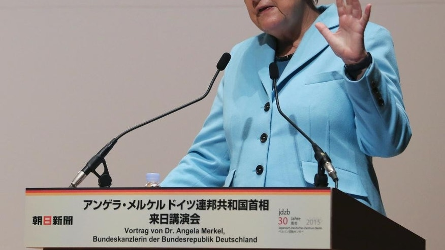Germany's Chancellor Angela Merkel speaks during a lecture meeting at Asahi Shimbun headquarters in Tokyo, Monday, March 9, 2015.  Merkel is in Japan on Monday and Tuesday as part of a series of bilateral meetings with G-7 leaders ahead of a June summit in Germany. (AP Photo/Koji Sasahara, Pool)