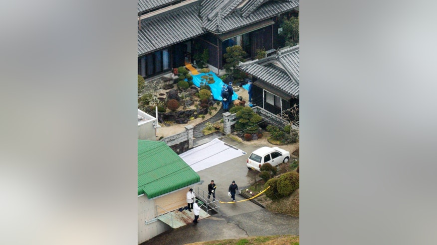 Police inspect a house where a stabbing murder took place in Sumoto, Hyogo prefecture, Monday, March 9, 2015. Police say five people have been killed in a stabbing spree in a small town in western Japan. A 40-year-old man has been arrested in connection with the Monday morning attacks.(AP Photo/Kyodo ews) JAPAN OUT, MANDATORY CREDIT