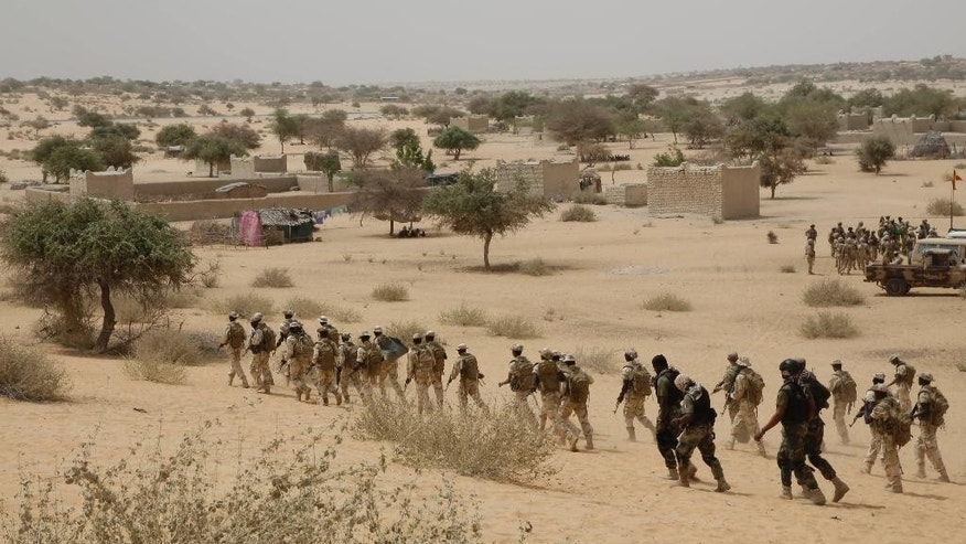 Chadian troops participate along with Nigerian special forces in an hostage rescue exercise at the end of the Flintlock exercise in Mao, Chad, Saturday, March 7, 2015. The U.S. military and its Western partners conduct this training annually and set up plans long before Boko Haram began attacking its neighbors Niger, Chad and Cameroon. (AP Photo/Jerome Delay)