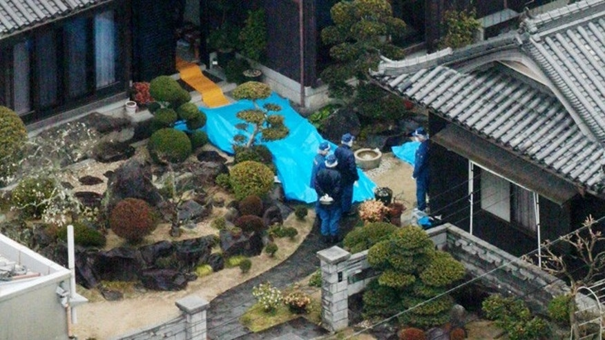 March 9, 2015: Police inspect a house where a stabbing murder took place in Sumoto, Hyogo prefecture. Police say five people have been killed in a stabbing spree in a small town in western Japan. A 40-year-old man has been arrested in connection with the Monday morning attacks.(AP Photo/Kyodo ews)