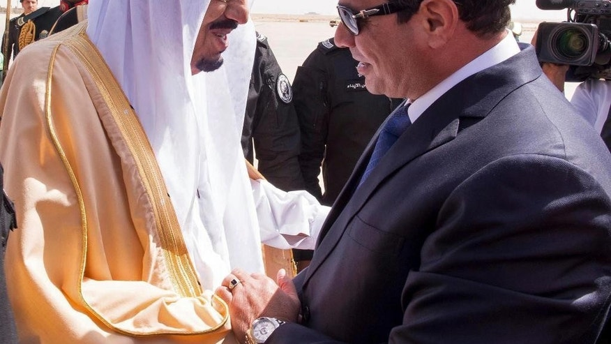 FILE - In this Sunday, March 1, 2015 file photo provided by the Saudi Press Agency, Saudi King Salman, left, greets Egyptian President Abdel-Fattah el-Sissi on his arrival to Riyadh Airbase, Riyadh, Saudi Arabia, Sunday, March 1, 2015.  Under its new monarch, Saudi Arabia is moving to improve relations with Turkey and Qatar and perhaps soften its stance against the Muslim Brotherhood, all with the aim of weakening Iran. But the shift could open rifts with its ally Egypt. (AP Photo/SPA, File)