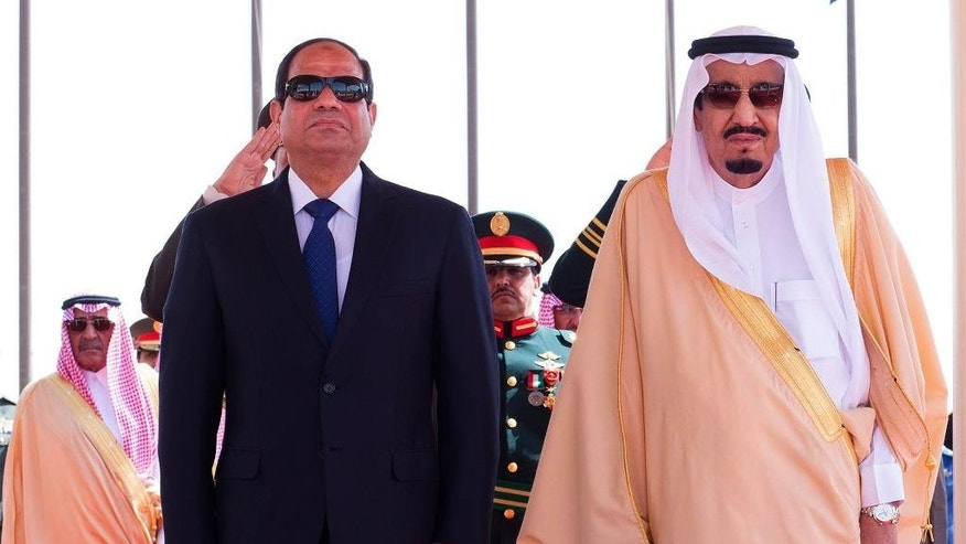 FILE - In this Sunday, March 1, 2015 file photo provided by the Saudi Press Agency, Saudi King Salman, right, stands with Egyptian President Abdel-Fattah el-Sissi during his arrival ceremony at Riyadh Airbase, Riyadh, Saudi Arabia. Under its new monarch, Saudi Arabia is moving to improve relations with Turkey and Qatar and perhaps soften its stance against the Muslim Brotherhood, all with the aim of weakening Iran. But the shift could open rifts with its ally Egypt. (AP Photo/SPA, File)