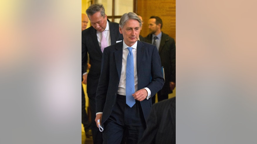 "British Foreign Minister Philip Hammond arrives to addresses the media in London, Tuesday March 10, 2015, commenting on the situation in Ukraine and Britain's Intelligence and Security services. Hammond strongly defended Britain's intelligence services, countering recent allegations by Muslim advocacy organization CAGE, saying people who act as ""apologists"" for terrorists are partly to blame. (AP Photo/Justin Tallis, pool)"