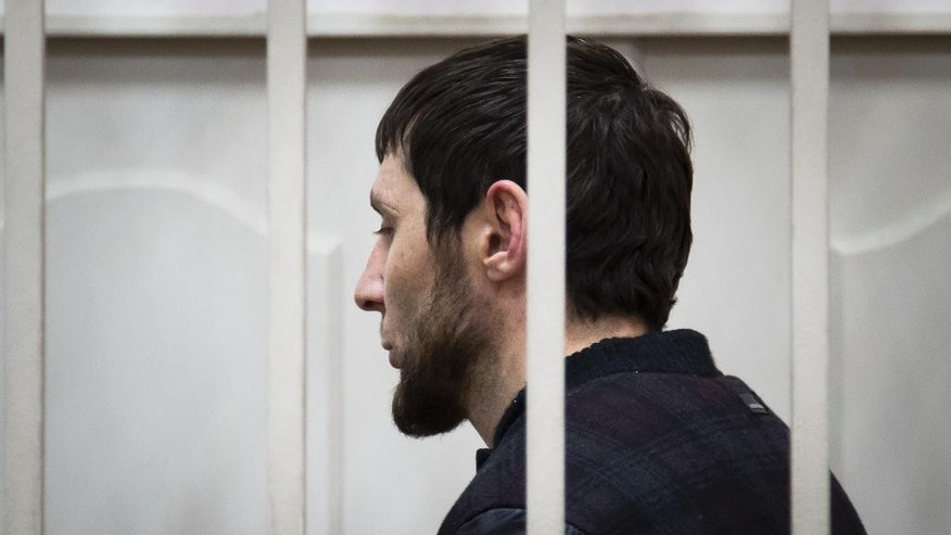 Zaur Dadaev, one of five suspects in the killing of Boris Nemtsov stands in a court room in Moscow, Russia, Sunday, March 8, 2015. Russian news agencies said Sunday one of the suspects in the killing of leading opposition figure Boris Nemtsov has admitted involvement in the crime. Judge Nataliya Mushnikova said that Zaur Dadaev made a statement confirming his guilt, according to the reports. They did not specify his alleged actions. Dadaev is among five suspects detained in the Feb. 27 killing, when Nemtsov was shot while walking on a bridge near the Kremlin. Another man, Anzor Gubashev, was charged in the killing, and a hearing for three other unnamed suspects was under way, court spokeswoman Anna Fadeeva said earlier Sunday. Dadaev and Gubashev were identified as suspects by Federal Security Service director Alexander Bortnikov a day earlier. Bortnikov gave no details of how the men were detained or specifics on how they were connected to the killings. (AP Photo/Ivan Sekretarev)