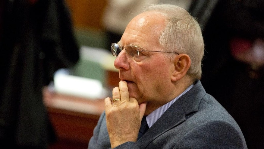German Finance Minister Wolfgang Schaeuble waits for the start of a meeting of EU finance ministers at the EU Council building in Brussels on Tuesday, March 10, 2015. Ministers on Tuesday will discuss the EU's banking union, the European semester and strategic investment. (AP Photo/Virginia Mayo)