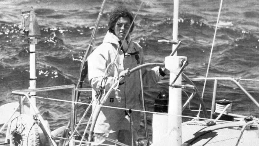 In this May 26, 1979 file photo, Florence Arthaud of France steers her 15 meter monohull called Biotherm off the Brittany coast. Two helicopters carrying French sports stars filming a popular European reality show crashed Monday March 9, 2015 in a remote part of Argentina, killing10 people, including two Olympic medal winners and sailing champion Florence Arthaud, authorities said.