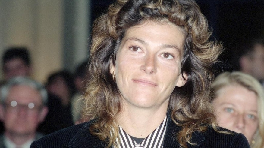 This Dec. 14, 1990 photo shows French sailor Florence Arthaud during a presentation in Paris. Two helicopters carrying French sports stars filming a popular European reality show crashed Monday March 9, 2015 in a remote part of Argentina, killing10 people, including two Olympic medal winners and sailing champion Florence Arthaud, authorities said.