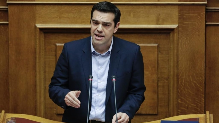 Greece's Prime Minister Alexis Tsipras speaks during a parliament session in Athens, on Tuesday, March 10, 2015. Tsipras spoke during a special debate on whether to revive a parliamentary committee that would seek German World War II reparations that Greece says were never fully paid. The committee would also seek the return of a forced loan  raised by Nazi occupation forces, and of Greek antiquities removed during the war. (AP Photo/Petros Giannakouris)
