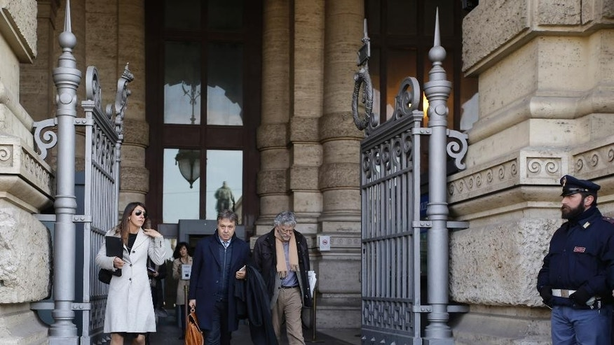 "Filippo Dinacci, center, one of the lawyers of former Italian Premier Silvio Berlusconi, leaves the Cassation Court building, in Rome, Tuesday, March 10, 2015. Italy's highest court was deliberating Tuesday what could be the final appeal in former Premier Silvio Berlusconi's infamous ""bunga-bunga"" case. The Court of Cassation will decide whether or not to make final Berlusconi's acquittal by an appellate court on charges of paying for sex with an underage prostitute during sex-fueled parties at his Milan villa, and using his influence to cover it up. (AP Photo/Gregorio Borgia)"