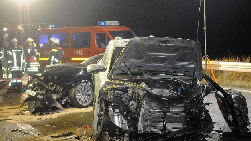 Nov. 5, 2011: In this file photo, rescue workers stand beside a car wreck in Niedernhausen near Wiesbaden, western Germany. (AP/dpa, Juergen Mahnke, file)