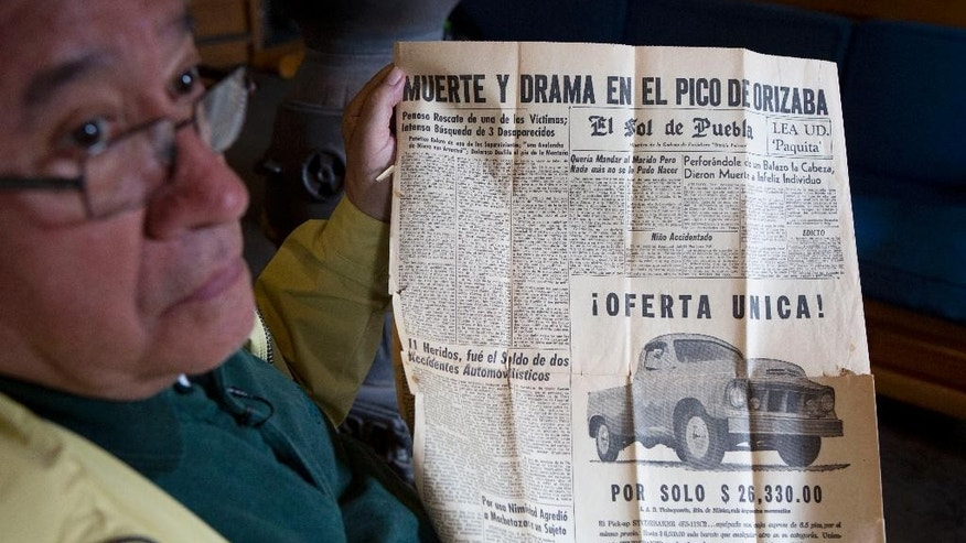 "Retired mountaineer Luis Espinoza, 78, a surviving member of a 1959 avalanche on Pico de Orizaba, in which one climber died and three others disappeared, shows a newspaper he saved from November 1959 with the Spanish headline: ""Death and Drama on Pico de Orizaba"" during an interview in Tlachichuca in Mexico's Puebla state, Tuesday, March 10, 2015. Espinoza is convinced that two mummified bodies discovered last week in a glacier on Mexico's tallest peak are the remains of his missing fellow climbers. (AP Photo/Rebecca Blackwell)"