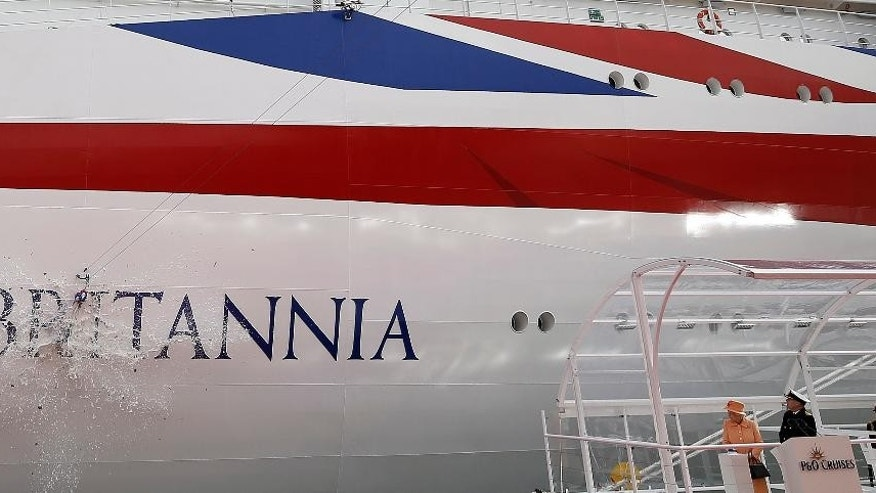Queen Elizabeth II, standing on the stage at left,  officially names new cruiser liner Britannia, in Southampton England Tuesday March 10, 2015. The Queen christened P&O Cruises' 141,000-ton liner Britannia  a 473 million pound ($714 million) mega ship that's longer than four superjumbo jets.   (AP Photo/Steve Parsons/PA) UNITED KINGDOM OUT