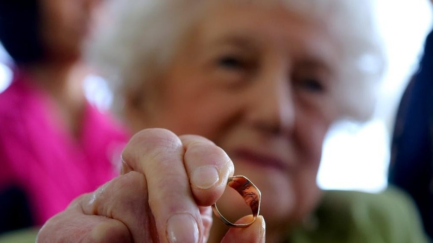 March 9, 2015: Dorothy Webster holds the ring of her dead brother, 23-year old British pilot Sgt. John Thompson, in Tirana.
