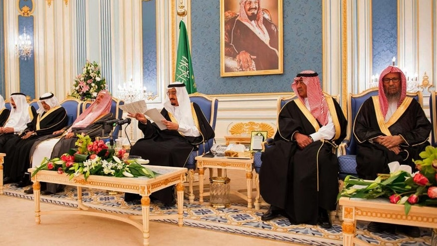 In this photo provided by the Saudi Press Agency, Saudi King Salman delivers his first major policy speech since assuming the throne, in the al-Yamama palace, Riyadh, Saudi Arabia, Tuesday, March 10, 2015. Salman vowed continuity and progress despite low oil prices, and promised that the kingdom would play an important role defending Arab and Muslim causes around the world. The 79-year-old monarch stressed at the opening of his speech that the kingdom holds tight to its religious pillars and foundation. (AP Photo/SPA)