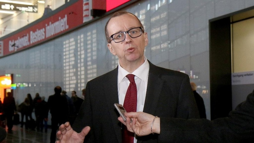 Tero Tapio Varjoranta Deputy Director General and Head of the Department of Safeguards of the International Atomic Energy Agency, IAEA, is interviewed as he arrives after his flight from Iran at Vienna's Schwechat airport, in Vienna, Austria, Tuesday, March 10, 2015. (AP Photo/Ronald Zak)