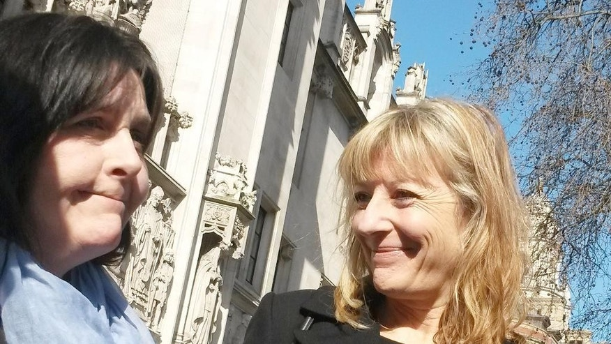 Kathleen Wyatt, left, with lawyer Barbara Reeves, outside the Supreme Court, London, Wednesday March 11, 2015. Britain's Supreme Court gave a British woman the right to pursue a claim against her ex-husband decades after they parted ways. In a landmark ruling the court said Wednesday that Kathleen Wyatt, 55, was entitled to compensation from ex-husband Dale Vince, 53. The couple divorced in 1992, but didn't take the step of settling their financial affairs. (AP Photo/PA, Ryan Hooper) UNITED KINGDOM OUT  NO SALES  NO ARCHIVE