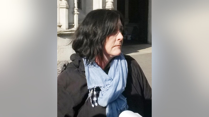 Kathleen Wyatt outside the Supreme Court, London, Wednesday March 11, 2015. Britain's Supreme Court gave a British woman the right to pursue a claim against her ex-husband decades after they parted ways. In a landmark ruling the court said Wednesday that Kathleen Wyatt, 55, was entitled to compensation from ex-husband Dale Vince, 53. The couple divorced in 1992, but didn't take the step of settling their financial affairs. (AP Photo/PA, Ryan Hooper) UNITED KINGDOM OUT  NO SALES  NO ARCHIVE