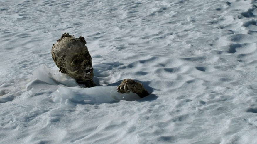 A mummified frozen body sticks out from the snow in a glacier on the Pico de Orizaba volcano, Mexico's tallest peak.