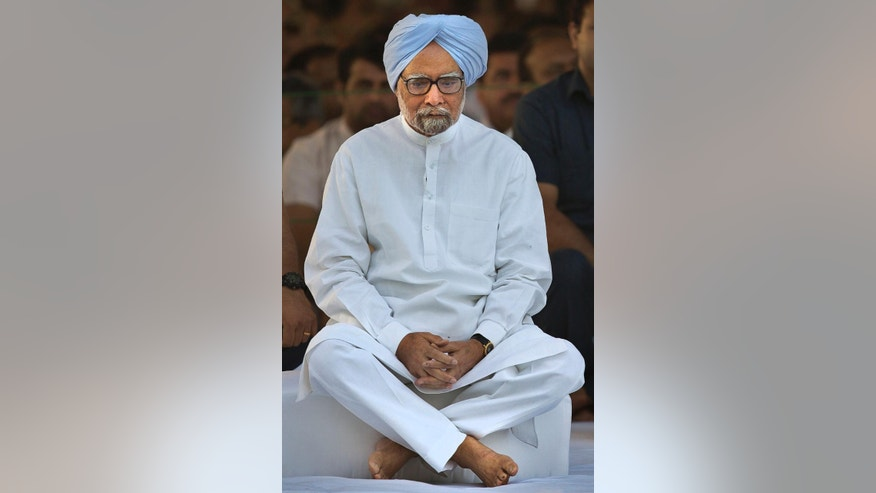 FILE - In this Wednesday, May 21, 2014 file photo, outgoing Indian prime minister Manmohan Singh attends a function marking the death anniversary of former Indian prime minister Rajiv Gandhi, in New Delhi, India. A special court on Wednesday, March 11, 2015, charged Singh with corruption and criminal conspiracy for his alleged role in a multibillion dollar scandal over the sale of coal fields. Judges ordered Singh and five others to appear in court on April 8. (AP Photo/Manish Swarup, File)