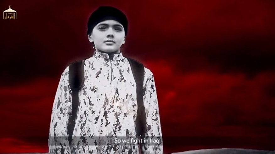 This child appears to execute a man who admits spying for the Mossad in a new video released by ISIS. (Screengrab)