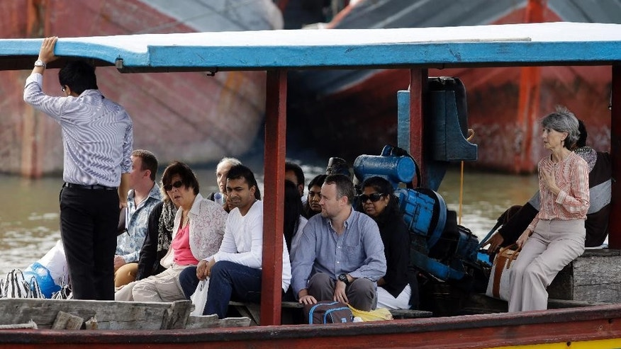 Family members of Australian death row prisoners Andrew Chan and Myuran Sukumaran and Australian Consul-General in Bali Majell Hind, right, head to Nusakambangan Island by a ship at Wijaya Pura port in Cilacap, Central Java, Indonesia, Wednesday, March 11, 2015. The relatives made their second visit to the Indonesian prison island where the convicted drug traffickers are to be executed soon by firing squads. (AP Photo/Achmad Ibrahim)