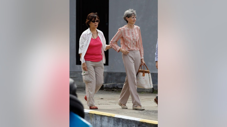 Helen Chan, left, the mother  of Australian death row prisoner Andrew Chan, walks with Australian Consul-General in Bali Majell Hind toward a ship for heading to Nusakambangan Island, in Cilacap, Indonesia Wednesday, March 11, 2015. The relatives made their second visit to the Indonesian prison island where the convicted drug traffickers are to be executed soon by firing squads. (AP Photo/Achmad Ibrahim)
