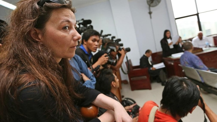 Sabine Atlaoui, left, the wife of Serge Atlaoui, a French national who is on death row after being convicted of drug offences, attends her husband's judicial review hearing at the district court in Tangerang, Indonesia, Wednesday, March 11, 2015. Atlaoui is among nine foreign drug criminals who are to be executed soon despite clemency appeals from several of their governments. An Indonesian is also scheduled to be executed. (AP Photo/Tatan Syuflana)