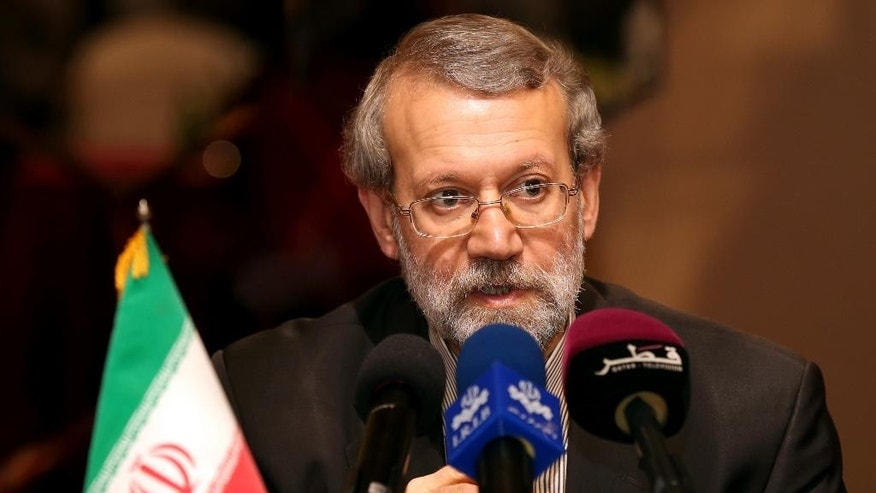 Iranian Parliament Speaker Ali Larijani speaks to the media during a news conference in Doha, Qatar, Wednesday, March 11, 2015. Larijani said that if it wasn't for Iran's assistance to the Iraqi people and government in confronting the extremist Islamic State group, more countries would be exposed to terrorism. (AP Photo/Osama Faisal)