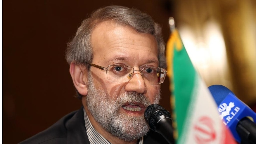 Iranian Parliament Speaker Ali Larijani speaks to the media during a press conference in Doha, Qatar, Wednesday, March 11, 2015. Larijani said that if it wasn't for Iran's assistance to the Iraqi people and government in confronting the extremist Islamic State group, more countries would be exposed to terrorism. (AP Photo/Osama Faisal)