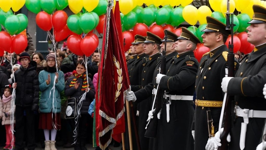 Lithuania's Honor Guards stand  during a celebration of Independence day at Independence Square, in front of the Parliament Palace in Vilnius, Lithuania, Wednesday, March 11, 2015. Lithuania celebrated the 25th anniversary of its declaration of independence from the Soviet Union on Wednesday, recalling the seminal events that set the Baltic nation on a path to freedom and helped lead to the collapse of the U.S.S.R. (AP Photo/Mindaugas Kulbis).