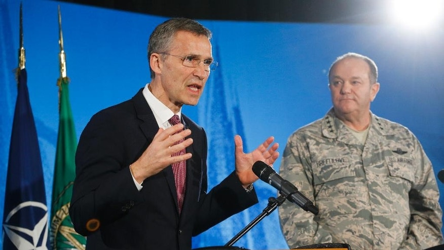NATO Secretary General Jens Stoltenberg, left, and the Supreme Allied Commander Europe, General Philip Breedlove address the media at Supreme Headquarters Allied Powers in Europe (SHAPE) in Mons, Belgium on Wednesday, March 11, 2015. NATO's secretary-general is insisting international observers be given the freedom of movement and protection they need to monitor the cease fire in Ukraine. (AP Photo/Olivier Hoslet, Pool)