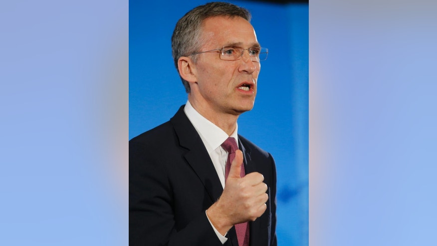 NATO Secretary General Jens Stoltenberg address the media at Supreme Headquarters Allied Powers in Europe (SHAPE) in Mons, Belgium on Wednesday, March 11, 2015. NATO's secretary-general is insisting international observers be given the freedom of movement and protection they need to monitor the cease fire in Ukraine. (AP Photo/Olivier Hoslet, Pool)