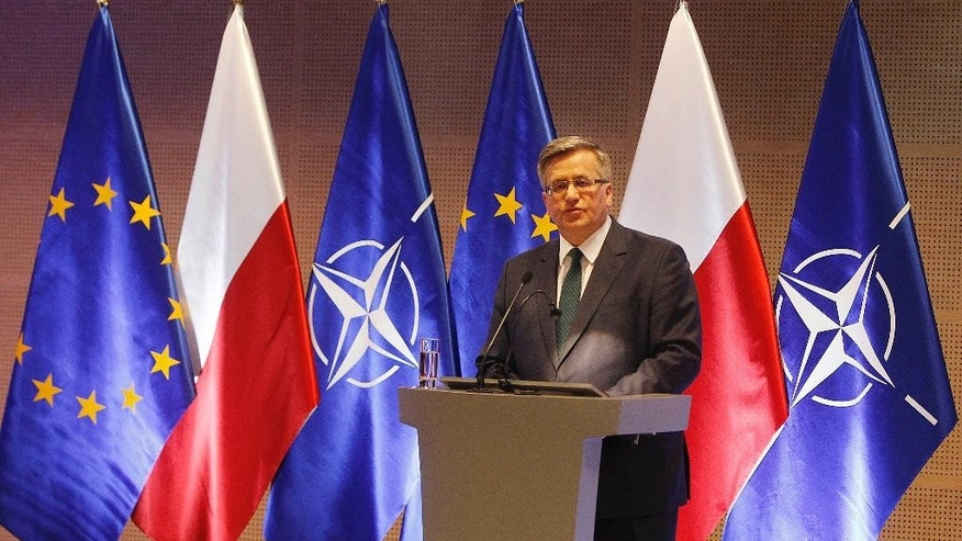 Poland's President Bronislaw Komorowski delivers a speech during the start of an annual conference of Polish army commanders at the National Stadium in Warsaw, Poland, on Wednesday, March 11, 2015. German Defense Minister Ursula von der Leyen was a special guest at the meeting that is to set tasks for the Polish army at a time of armed conflict in eastern Ukraine, across Poland's eastern border. (AP Photo/Czarek Sokolowski)