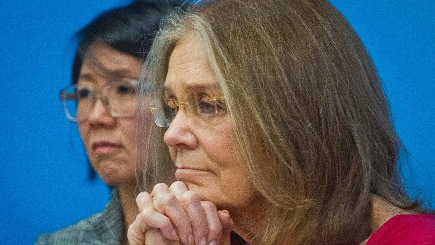 Organizers of the effort called WomenCrossDMZ.org, including honorary co-chair Gloria Steinem, right, and lead coordinator Christine Ahn, left, listen during a United Nations news conference announcing plans for a rare and risky women's walk across the demilitarized zone between North and South Korea to call for reunification, Wednesday, March 11, 2015. (AP Photo/Bebeto Matthews)