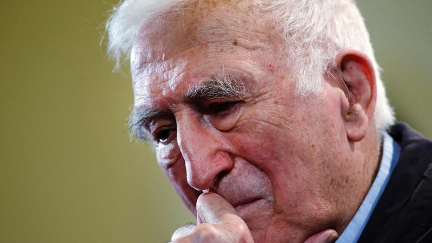 Jean Vanier, the founder of L'ARCHE, an international network of communities where people with and without intellectual disabilities live and work together, gathers his thoughts during a news conference, in central London, Wednesday, March 11, 2015. Vanier has been awarded the 2015 Templeton Prize. Valued at 1.1 million British pounds (some 1.7 million US dollars, some 1.5 million Euro), the Templeton Prize has been one of the world's largest annual monetary awards given to an individual for over 40 years, according to the organization. (AP Photo/Lefteris Pitarakis)
