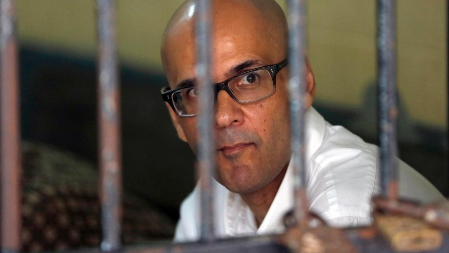 Canadian teacher Neil Bantleman sits inside a holding cell prior to the start of his trial hearing to listen to the prosecutor's demand at South Jakarta District Court in Jakarta, Indonesia, Thursday, March 12, 2015. Bantleman and Indonesia teaching assistant Ferdinant Tjiong were on trial on accusation of sexually abusing a kindergartner on the campus of a prestigious international school in the capital. (AP Photo/Dita Alangkara)