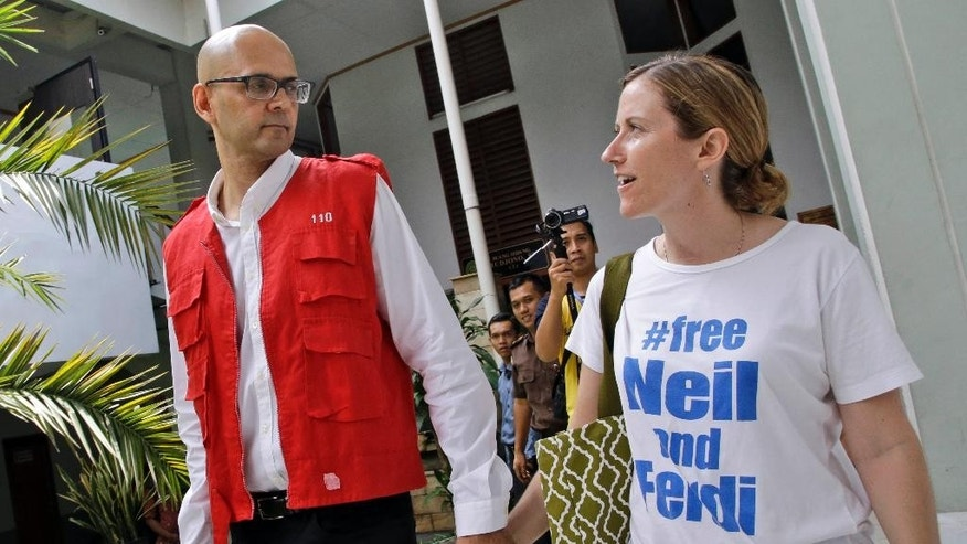 Canadian teacher Neil Bantleman, left, walks with his wife Tracy prior to the start of his trial hearing to listen to the prosecutor's demand at South Jakarta District Court in Jakarta, Indonesia, Thursday, March 12, 2015. Bantleman and Indonesian teaching assistant Ferdinant Tjiong were on trial on accusation of sexually abusing a kindergartner on the campus of a prestigious international school in the capital. (AP Photo/Dita Alangkara)