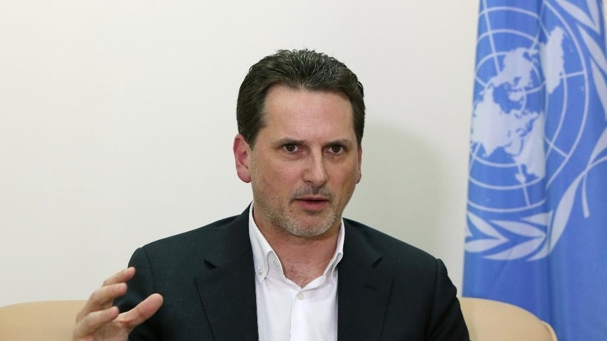 Pierre Krahenbuhl, director of the UN agency that supports Palestinians, speaks during an interview with The Associated Press in Beirut, Lebanon, Thursday, March 12, 2015. Krahenbuhl is calling for greater access for humanitarian aid to a besieged Palestinian camp in the Syrian capital where up to 18,000 people continue to live in desperate conditions. (AP Photo/Bilal Hussein)