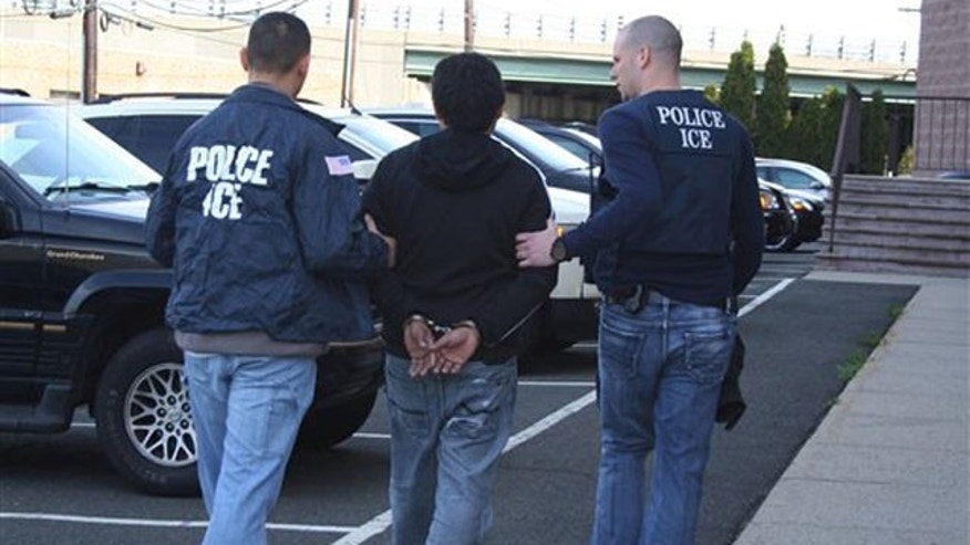 This photo provided by the U.S. Immigration and Customs Enforcement, Wednesday, March 28, 2012, in New Jersey,  shows agents taking a person into custody during operation Cross Check III. The Obama administration said it arrested more than 3,100 immigrants who were illegally in the country and who were convicted of serious crimes or otherwise considered fugitives or threats to national security. It was part of a six-day nationwide sweep that the government described as the largest of its kind. (AP Photo/U.S. Immigration and Customs Enforcement)