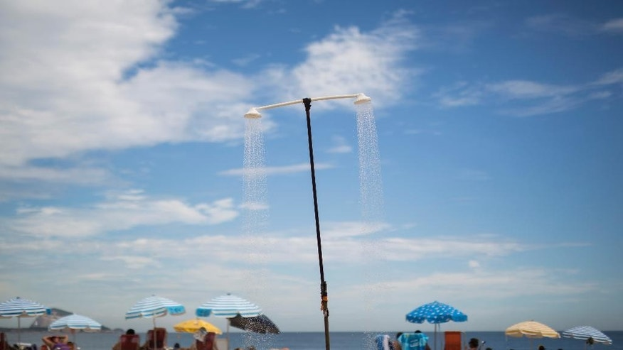 A shower runs continuously on Leblon beach in Rio de Janeiro, Brazil, Wednesday, March 11, 2015. A historic drought making taps run dry across southeastern Brazil, particularly in South America's largest city of Sao Paulo, has people worried they might be asked to cut down on their beloved showers. (AP Photo/Felipe Dana)