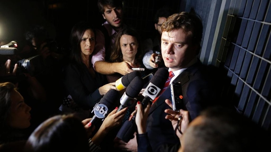 Cesare Battisti's attorney, Igor Sant'Anna Tamasauskas, talks with the press outside the Federal Police headquarters where his client is being held in Sao Paulo, Brazil, Thursday, March 12, 2015. Brazil's federal police arrested former Italian communist militant Cesare Battisti on Thursday on a judge's deportation order. Battisti is a fugitive from Italian murder convictions. (AP Photo/Nelson Antoine)