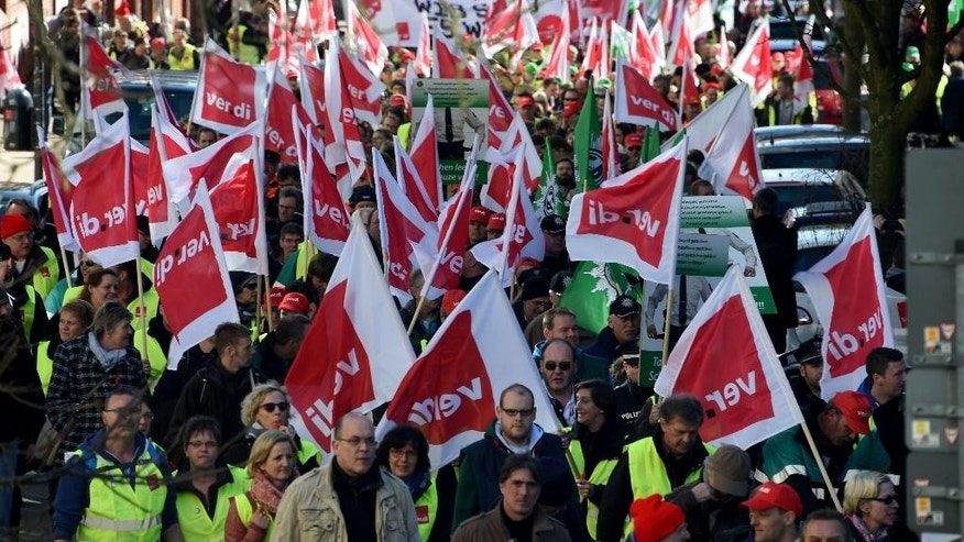 German public service workers join al rally in a bid to receive higher wages and preserve pension benefits in Kiel, northern Germany, Wednesday, March 11, 2015. The ver.di union said teachers and other public employees including police and firefighters walked off the job in multiple states in Germany. (AP Photo/dpa, Carsten Rehder)